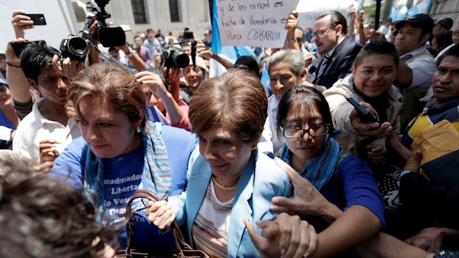 Guatemalan Congresswoman Montenegro is escorted by supporters as she arrives to the Congress for a session to decide if Guatemalan President Perez Molina is to be stripped of his presidential immunity in Guatemala City