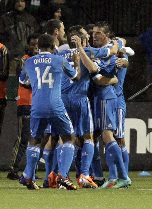 Philadelphia Union players celebrate scoring during the second half of an MLS soccer game against the Portland Timbers in Portland, Ore., Saturday, March 8, 2014.  The teams tied 1-1