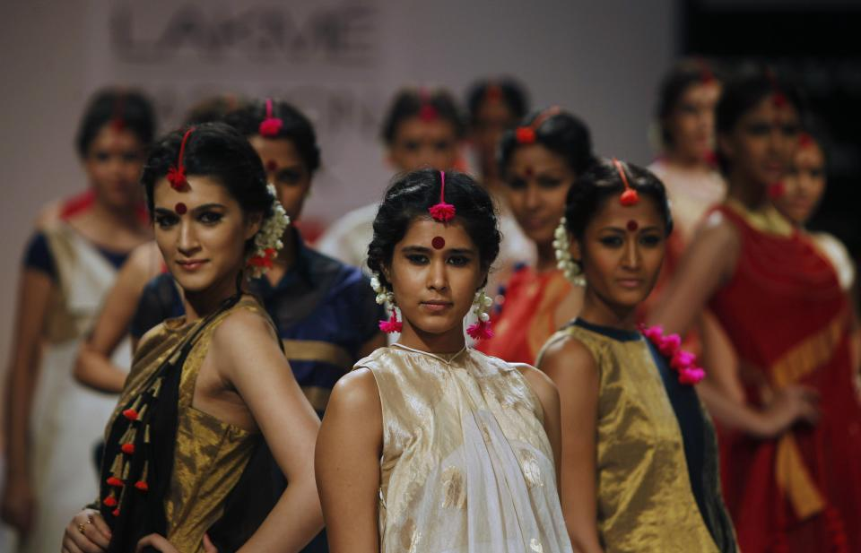 Indian models display creations by Vaishali. S during the Lakme Fashion Week in Mumbai, India, Sunday, Aug. 5, 2012. (AP Photo/Rafiq Maqbool)