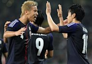 Japan&#39;s Keisuke Honda (L) and teammate Shinji Kagawa celebrate a goal during the football friendly against Azerbaijan on May 23. Japan are one of the 10 Asian teams left who are battling for four-and-half spots at the 2014 tournament in Brazil