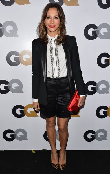 "Rashida Jones: The ""Parks and Recreation"" actress wears a killer menswear outfit with a long tuxedo blazer, satin shorts and a preppy blouse. Topped with a red clutch and leopard-print shoes, Jones st"
