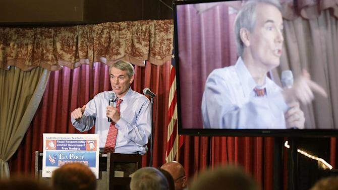 U.S. Sen. Rob Portman, R-Ohio, speaks at a gathering of tea party activists, Wednesday, May 29, 2013, in Cincinnati. Portman and Rep. Steve Chabot, R-Ohio, said the key question about the Internal Revenue Service's handling of conservative groups is who in the Obama administration was involved. (AP Photo/Al Behrman)