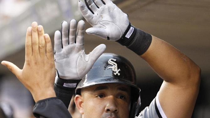 Abreu hits 30th HR, White Sox beat Twins 9-5
