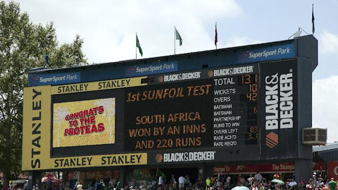 An electronic score board displays the results on the fourth day of the 1st cricket test match at Centurion Park in Pretoria, South Africa, Saturday, Dec. 20, 2014. South Africa beat West Indies by an innings and 220 runs. (AP Photo/Themba Hadebe)