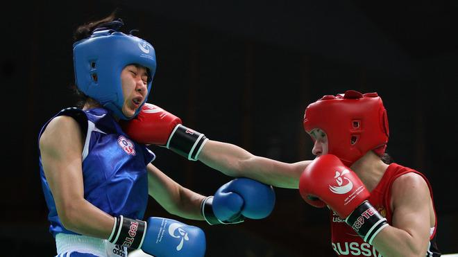 Pin Meng-Chieh (Blue) Of Chinese Taipei Fighting Against Elena Savelyeva (Red) Of Russia In The Women's 51kg Getty Images