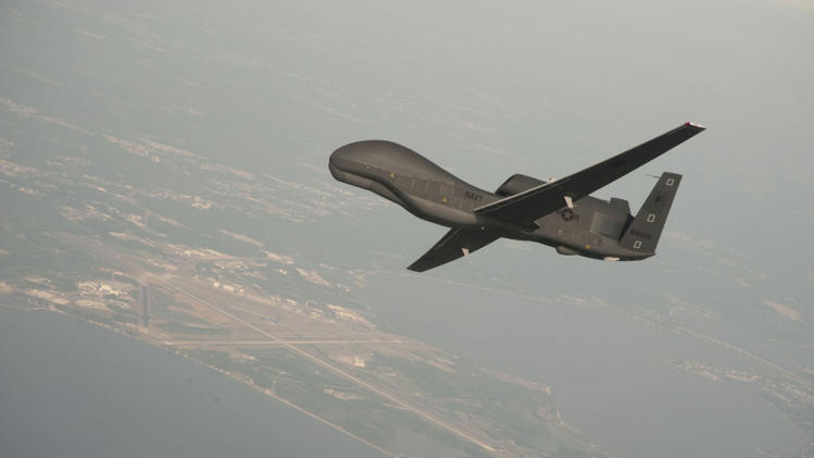 In this undated handout photo provided by Northrop Grumman via the U.S. Navy, an RQ-4 Global Hawk unmanned aerial vehicle conducts tests over Naval Air Station Patuxent River, Md. On Monday, June 11, 2012 an RQ-4A aircraft on a routine training flight crashed near Bloodsworth Island, across the Chesapeake Bay from the Naval Air Station, but no injuries or property damage was reported. (AP Photo/Northrop Grumman via U.S. Navy, Erik Hildebrandt)
