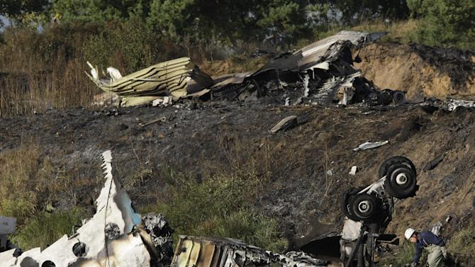 Wreckage of Russian Yak-42 jet, carrying a top ice hockey team, seen near the city of Yaroslavl, on the Volga River about 150 miles (240 kilometers) northeast of Moscow,  Russia, Wednesday, Sept. 7, 2011. A Russian jet carrying a top ice hockey team crashed while taking off Wednesday in western Russia, killing at least 36 people and leaving one critically injured, officials said.The Russian Emergency Situations Ministry said the Yak-42 plane crashed immediately after leaving an airport near the city of Yaroslavl, on the Volga River about 150 miles (240 kilometers) northeast of Moscow. It said one person survived the crash with grave injuries.(AP Photo/Misha Japaridze)