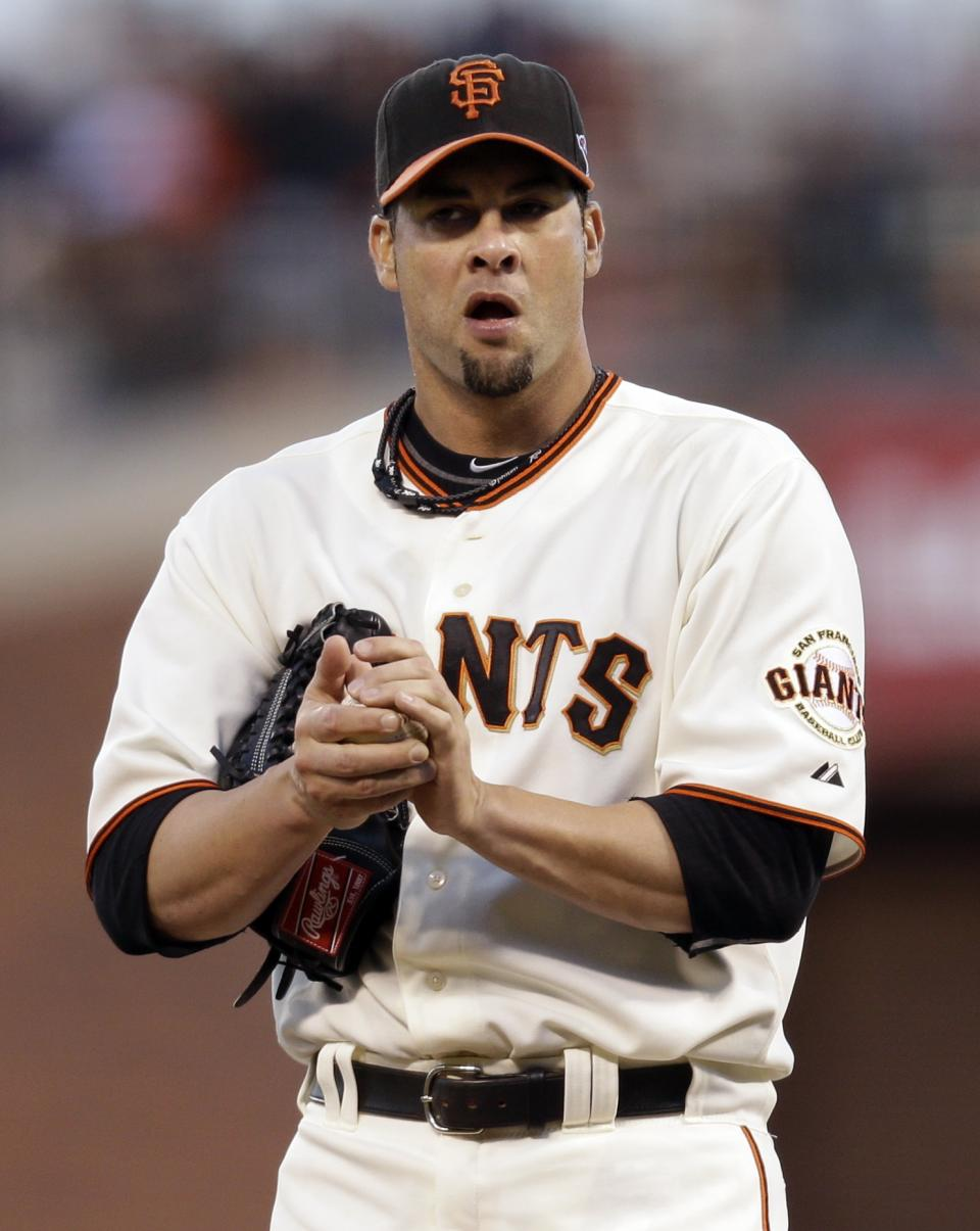 San Francisco Giants starting pitcher Ryan Vogelsong reacts after giving up a hit to St. Louis Cardinals' Daniel Descalso during the fifth inning of Game 6 of baseball's National League championship series Sunday, Oct. 21, 2012, in San Francisco. (AP Photo/Ben Margot)