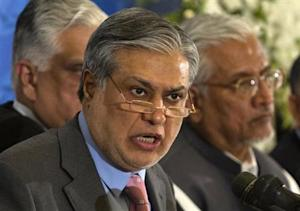Pakistan's Finance Minister Dar announces the result of the first auction for 3G mobile phone networks during a news conference in Islamabad