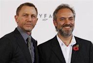 "Actor Daniel Craig and director Sam Mendes (R) pose while launching the start of production of the new James Bond film ""SkyFall"" at a restaurant in London November 3, 2011. REUTERS/Luke MacGregor/Files"