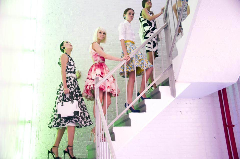 Models head upstairs to the show after hair and makeup at the alice + olivia by Stacey Bendet Spring 2013 presentation during Fashion Week in New York on Monday, Sept. 10, 2012. (Photo by Charles Sykes/Invision/AP)