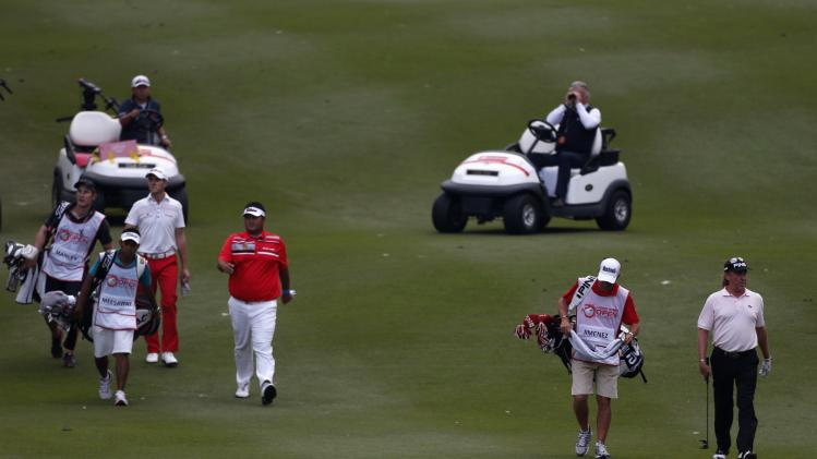 Defending champion Jimenez of Spain walks with Manley of Wales and Meesawat of Thailand during playoff of European Tour Hong Kong Open golf tournament