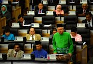 Malaysia Prime Minister Najib Razak presents the 2013 budget at Parliament House in Kuala Lumpur on September 28. Najib provided a fresh round of handouts in the voter-friendly budget aimed at shoring up support ahead of what is predicted to be a tough election