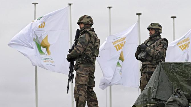 French soldiers stand on the site as tight security continues during the World Climate Change Conference 2015 at Le Bourget, near Paris, France