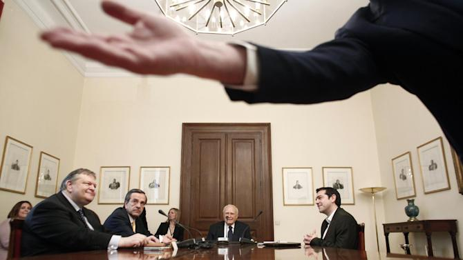Greek President Karolos Papoulias, center, Socialist leader Evangelos Venizelos, from left, Conservative leader Antonis Samaras and Leftist leader Alexis Tsipras meet at the presidential palace in Athens, Sunday, May 13, 2012. Greek President Karolos Papoulias has called the leaders of Greece's political parties to meetings on Sunday, in a last-ditch effort to broker a deal for a coalition government. (AP Photo/Kostas Tsironis)