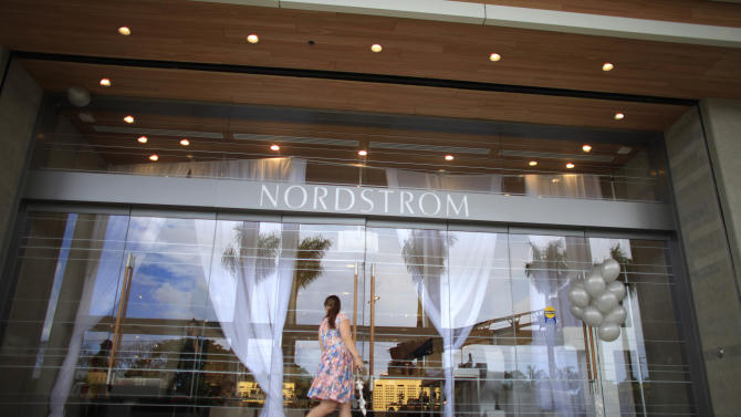 In this Monday, March 23, 2015 photo, a woman arrives at the Nordstrom luxury department store, at The Mall of San Juan, in San Juan, Puerto Rico. Developers expect to attract strong sales form a mix of tourists and locals thanks in part to its proximity to the main international airport and to Old San Juan, where cruise ships dock. (AP Photo/Ricardo Arduengo)
