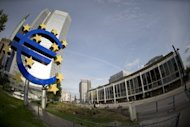File picture showing the Euro sign outside the ECB headquarters in Frankfurt. The European Central Bank is expected to hold fire on interest rates and other policy moves as it takes stock of the market impact of its latest anti-crisis plans