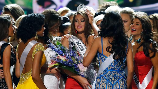 Miss Nevada USA Nia Sanchez celebrates with her competitors after being crowned Miss USA during the pageant in Baton Rouge, La., Sunday, June 8, 2014. (AP Photo/Jonathan Bachman)