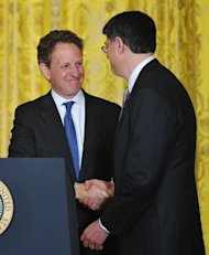 Outgoing Treasury Secretary Tim Geithner (L) shakes hands with White House Chief of Staff Jack Lew who was nominated by US President Barack Obama to be Geithner's successor in the East Room of the White House on January 10, 2013 in Washington, DC