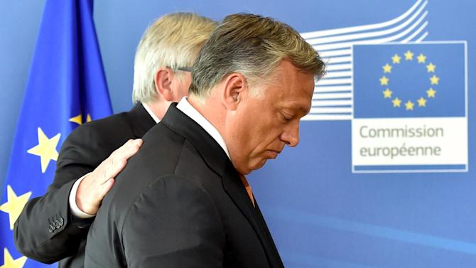Hungary's PM Orban is welcomed by EC President Juncker ahead of their meeting at the European Commission headquarters in Brussels