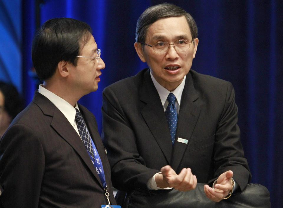 Taiwan's Interior Minister Jiang Yi-Hua, left, talks with his country's Minister of Economic Affairs Shih Yen-shiang during an APEC ministerial meeting at the Asia-Pacific Economic Cooperation summit Friday, Nov. 11, 2011, in Honolulu. (AP Photo/J. David Ake)