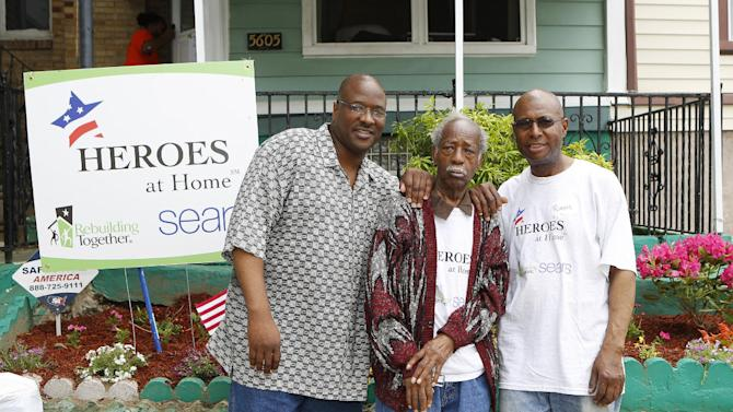 IMAGE DISTRIBUTED FOR SEARS - U.S. Airforce veteran Curtis Reed, center, son Robert Reed, right, a U.S. Army veteran, and grandson Clifton Connelly are seen in front of their home, undergoing renovation as part of Sears' sixth annual Heroes at Home program in partnership with Rebuilding Together in Philadelphia on Thursday, May 23, 2013. (Mark Stehle/AP Images for Sears)