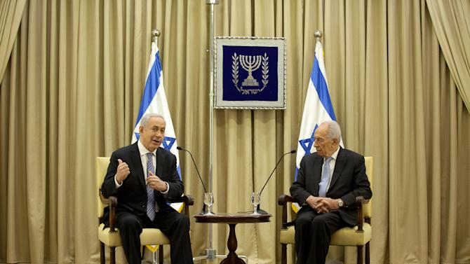 Israeli Prime Minister Benjamin Netanyahu, left, and Israeli President Simon Peres speak during a brief ceremony in the president's residence, on Saturday, March 2, 2013 in Jerusalem, Israel. (AP Photo/Uriel Sinai, Pool)