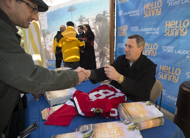 IMAGE DISTRIBUTED FOR GREATER FORT LAUDERDALE - Hockey legend Denis Savard greets fans as the Greater Fort Lauderdale Convention & Visitors Bureau says goodbye chilly, Hello Sunny today on Michigan Av
