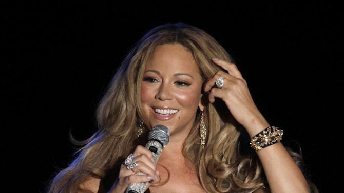 FILE - This June 2, 2012 file photo shows American singer Mariah Carey performing during a concert in Monaco. An 80-foot Norway spruce that made it through Superstorm Sandy will be lit Wednesday night, Nov. 28, 2012 at Rockefeller Center in an event scheduled to include performances from Carey and Tony Bennett, Rod Stewart, Cee Lo Green, and appearances from Billy Crystal and Bette Midler. (AP Photo/Lionel Cironneau, File)