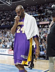 Los Angeles Lakers guard Kobe Bryant walks off the court after the Denver Nuggets&#39; 113-96 victory in Game 6 of the teams&#39;  first-round NBA basketball series in Denver on Thursday, May 10, 2012. Bryant played with stomach flu. (AP Photo/David Zalubowski)