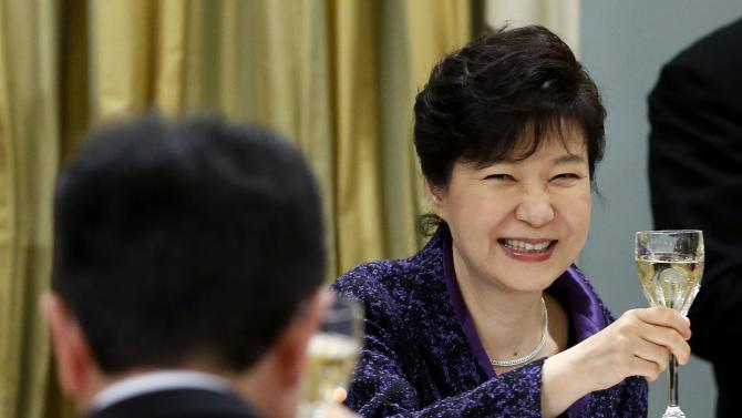 South Korea's President Park raises her glass for a toast during a state dinner at Rideau Hall in Ottawa