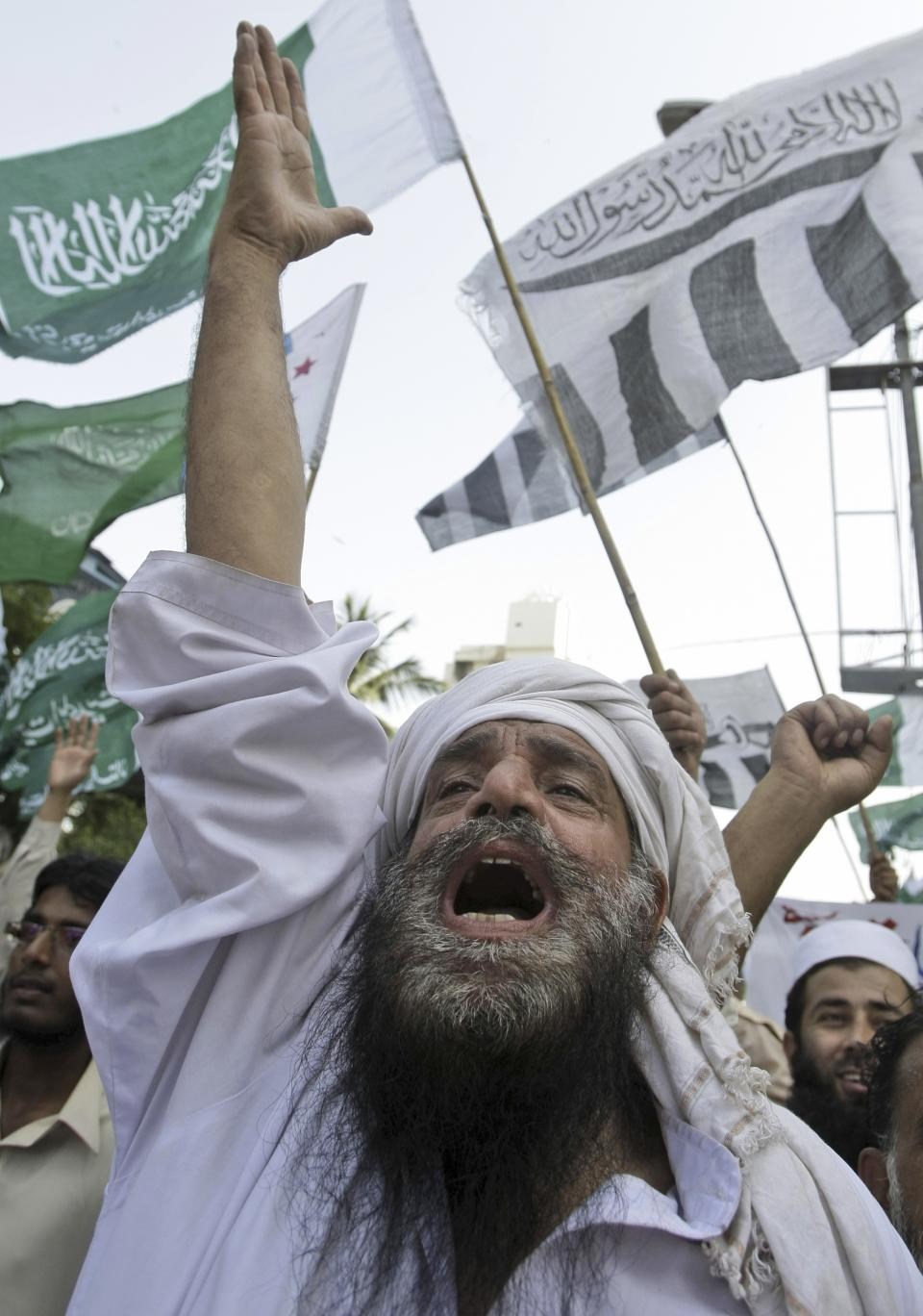 A Pakistani man, chants slogans along with other protestors, during a demonstration that is part of widespread anger across the Muslim world about a film ridiculing Islam's Prophet Muhammad, in Karachi, Pakistan, Sunday, Sept. 23, 2012. (AP Photo/Fareed Khan)