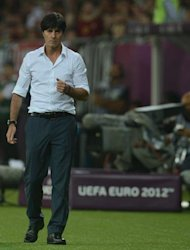 German headcoach Joachim Loew celebrates at the end of the Euro 2012 championships football match Germany vs Portugal on June 9, 2012 at the Arena Lviv. AFP PHOTO / PATRIK STOLLARZ