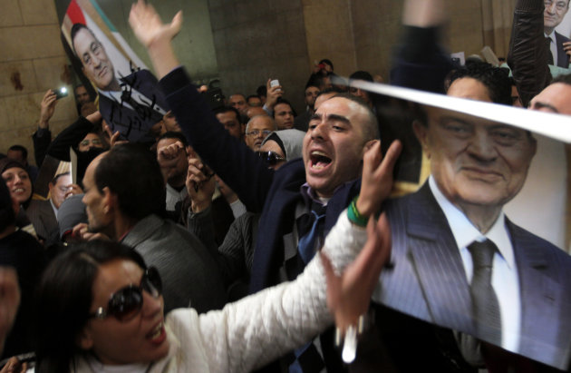 Egyptians supporters of ousted former President Hosni Mubarak celebrate an appeal granted by a court, in Cairo, Egypt, Sunday, Jan. 13, 2013. A court granted Hosni Mubarak's appeal of his life sentenc