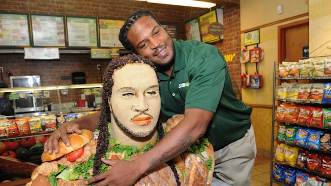 "IMAGE DISTRIBUTED FOR SUBWAY -Linebacker Jarvis Jones, 2013 draft prospect and newest Famous Fan of SUBWAY, unveils a life-size ""Smokehouse BBQ Chicken"" sculpture to announce his official SUBWAY Famous Fan title, Tuesday, April 23, 2013, in New York.  The sculpture is an artistic representation of the football star from the chest up, standing approximately three feet tall and made of almost entirely SUBWAY Smokehouse BBQ Chicken.  Jarvis joins a roster of fellow Famous Fans that include Robert Griffin III, Justin Tuck, Michael Strahan, Blake Griffin and Michael Phelps.† (Photo by Diane Bondareff/Invision for SUBWAY/AP Images)"