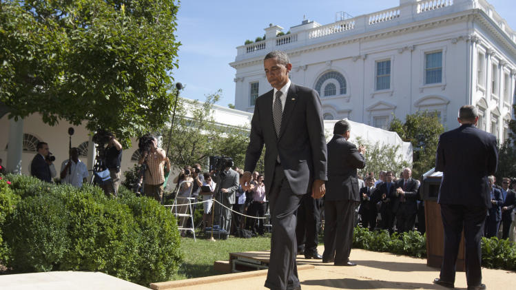 President Barack Obama walks from the podium after speaking in the Rose Garden of the White House in Washington, Wednesday, Aug. 31, 2011, to urge Congress to pass a federal highway bill. (AP Photo/Carolyn Kaster)