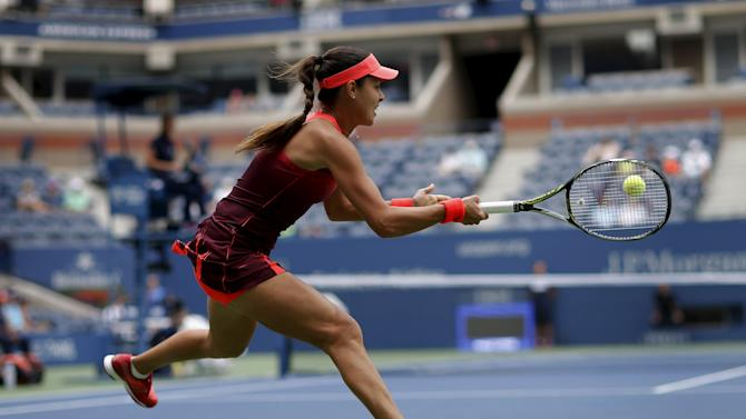 Ivanovic of Serbia hits a return to Cibulkova of Slovakia during their match at the US Open Championships tennis tournament in New York