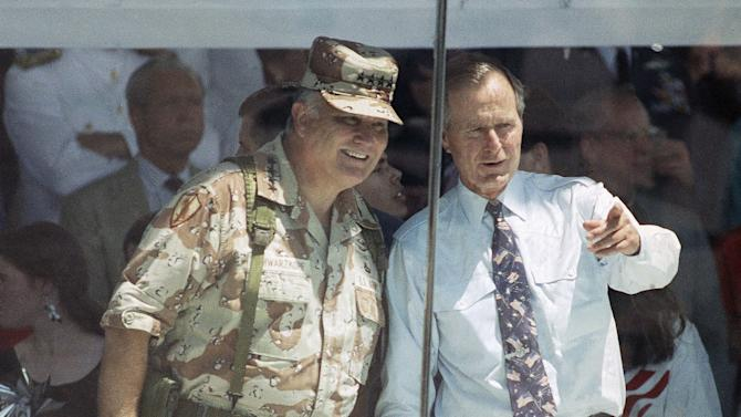 FILE - In this June 8, 1991 file photo, Gen. Norman Schwarzkopf and President George Bush watch the National Victory Parade from the viewing stand in Washington. Schwarzkopf led his troops in the parade, and then joined Bush in the reviewing stand.  Schwarzkopf died Thursday, Dec. 27, 2012 in Tampa, Fla. He was 78. (AP Photo/Ron Edmonds, File)