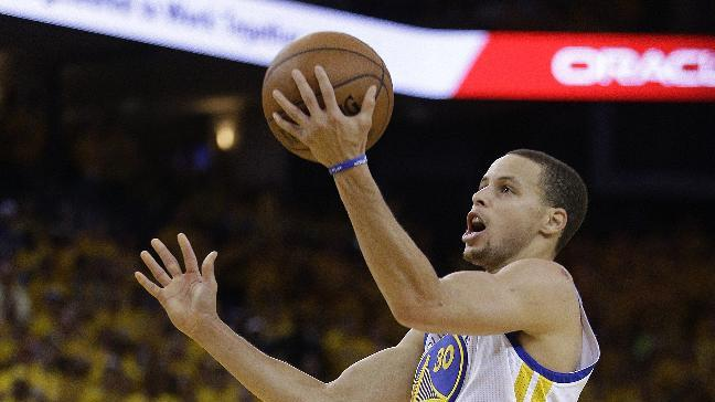 Golden State Warriors' Stephen Curry lays up a shot against the Denver Nuggets during the second half of Game 4 in a first-round NBA basketball playoff series on Sunday, April 28, 2013, in Oakland, Calif. (AP Photo/Ben Margot)