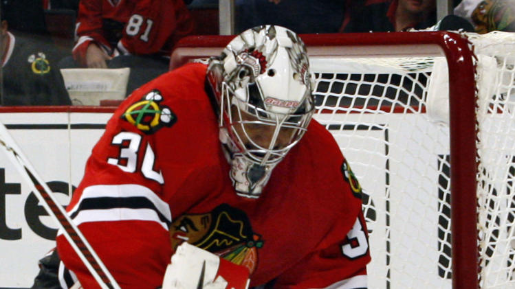 Chicago Blackhawks' goalie Ray Emery stops a shot from the Los Angles Kings in the first period of an NHL hockey game on Sunday, Feb. 17, 2013, in Chicago. (AP Photo/John Smierciak)
