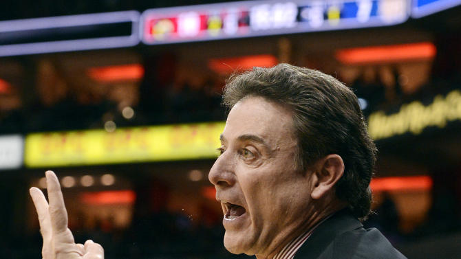 Louisville head coach Rick Pitino sends a play into his team during the first half of an NCAA college basketball game against Notre Dame, Saturday, March 9, 2013, in Louisville, Ky. Louisville defeated Notre Dame 73-57. (AP Photo/Timothy D. Easley)