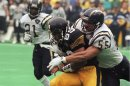 FILE - In this Jan. 15, 1995, file photo, San Diego Chargers' Junior Seau, right, tackles Pittsburgh Steelers Ernie Mills during the first quarter of the AFC Championship NFL football game in Pittsburgh. Senior U.S. District Judge Anita Brody in Philadelphia, announced Thursday, Aug. 29, 2013, that the NFL and more than 4,500 former players want to settle concussion-related lawsuits for $  765 million. The plaintiffs include at least 10 members of the Pro Football Hall of Fame, along with and the family of Seau, who committed suicide last year. The global settlement would fund medical exams, concussion-related compensation and medical research. (AP Photo/Keith Srakocic, File)