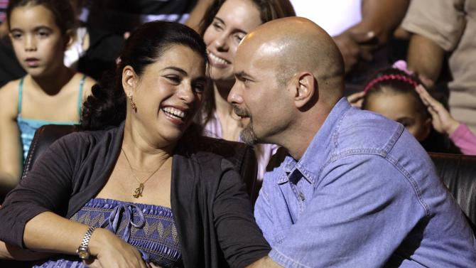 "Gerardo Hernandez , one of the so-called ""Cuban Five"", reacts with wife Adriana during Cuban musician Silvio Rodriguez's concert in Havana"