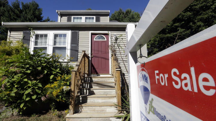 FILE - In this Wednesday, Sept. 18, 2013 photo a for sale sign hangs in front of a house in Walpole, Mass. Private data provider CoreLogic reports on home prices for September, on Tuesday, Nov. 5, 2013. (AP Photo/Steven Senne, File)