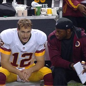Washington Redskins quarterback Robert Griffin III consoles Kirk Cousins after interception