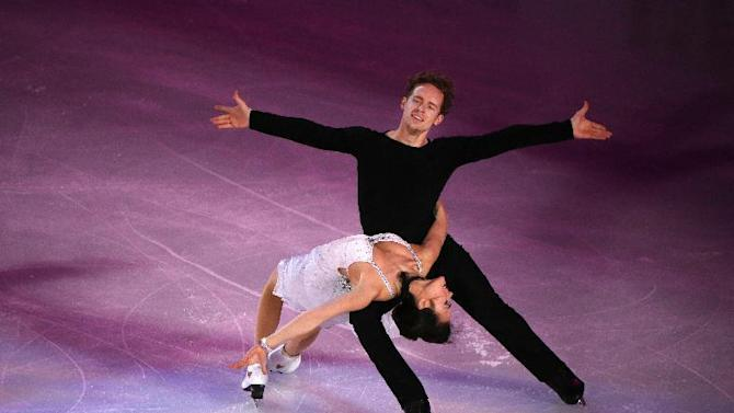 Madison Chock and Evan Bates of the United States perform during the Exhibition event in the ISU World Figure Skating Championship 2015 held at the Oriental Sports Center in Shanghai, China, Sunday, March 29, 2015. Chock and Bates won a silver medal in the Ice Dance Free Dance event. (AP Photo/Ng Han Guan)