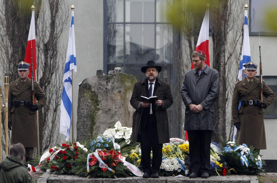 Poland's Chief Rabbi Michael Schudrich,center, prays in the heart of what was once the Warsaw Ghetto during a ceremony marking the 69th anniversary of the doomed Warsaw Ghetto Uprising, in Warsaw, Poland, on Thursday, April 19, 2012.  (AP Photo/Czarek Sokolowski)