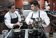 Commis Corey Siegel (L) listens to Chef Richard Rosendale while they practice in The Bunker below the Greenbrier Resort in White Sulphur Springs, West Virginia, on January 10, 2013. Rosendale, who runs the Greenbrier Resort's food operations, including its 13 restaurants, and Siegel will represent the US in the 2013 Bocuse D'Or, a biennial world chef championship in Lyon, France, end of January
