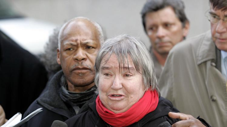 FILE - In this Feb. 10, 2005 file photo, attorney Lynne Stewart cries as she speaks to the press with her husband Ralph Pointer next to her, left, outside Federal Court in New York after she was convicted on all five charges regarding aiding terrorism, assisting terrorism and making false statements. The 2nd U.S. Circuit Court of Appeals said on Thursday, June 28, 2012 that it was fair two years ago to boost Lynne Stewart's sentence to 10 years in prison from the two-year, four-month sentence she was given in 2006. (AP Photo/David Karp, File)