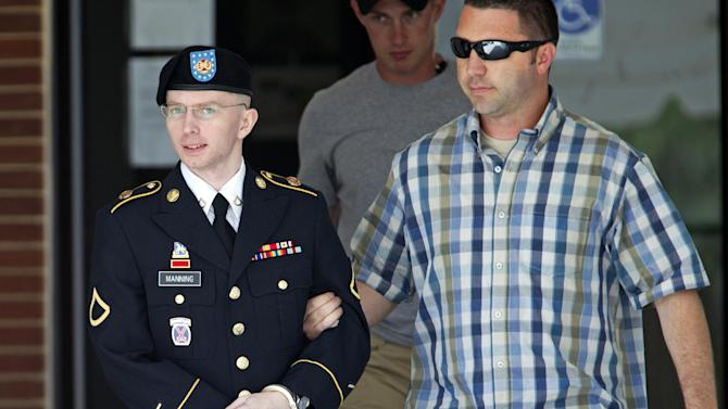 FILE - In this June 25, 2013 file photo, Army Pfc. Bradley Manning, left, is escorted out of a courthouse in Fort Meade, Md. A military judge is weighing the admissibility of three pieces of evidence suggesting Manning took his cues from WikiLeaks in disclosing classified information. Col. Denise Lind says she's preparing to rule as Manning's court-martial resumes Friday, June 28, 2013. (AP Photo/Jose Luis Magana, File)